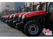 世纪红拖拉机助力农民发家致富 引领农机化发展新格局