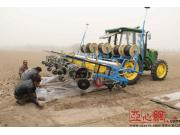 新疆部分地州農機使用智能技術春播